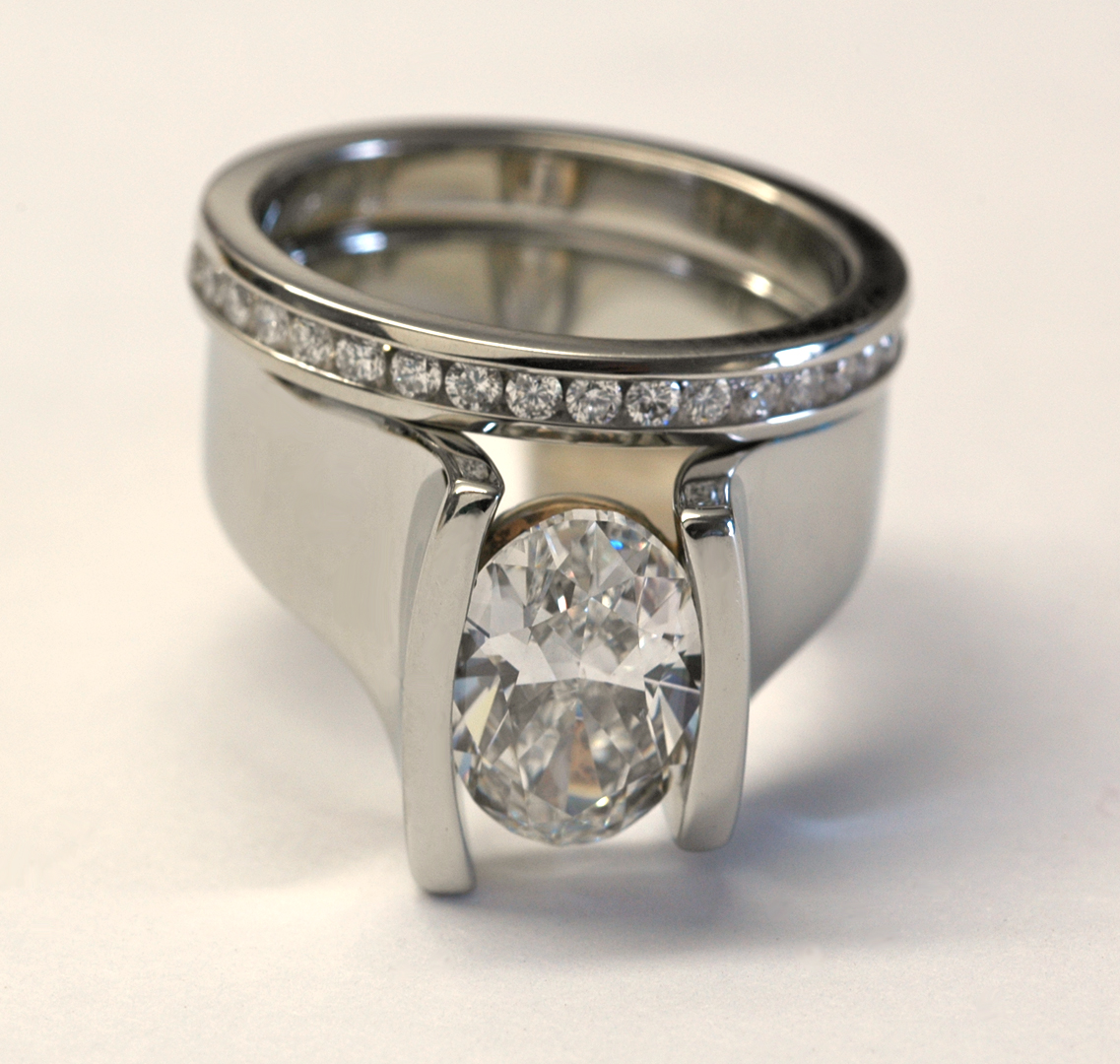 18kt white gold oval diamond contemporary ring with eternity band