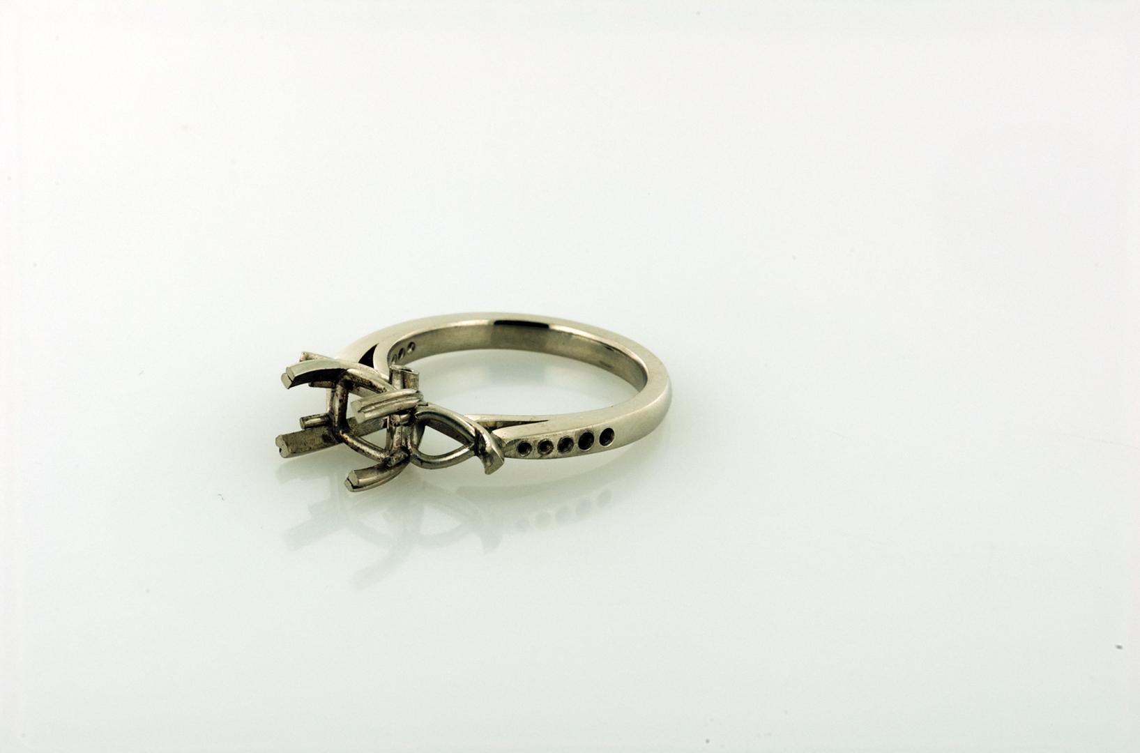 Three stone platinum ring before setting