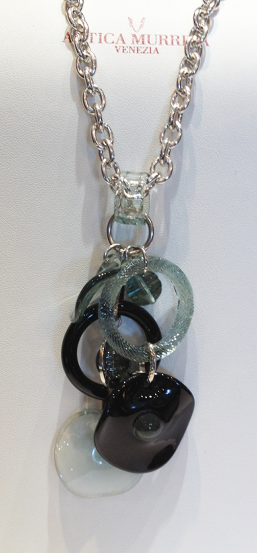 Murrano glass pendant of multiple glass discs in black, clear and green glass.