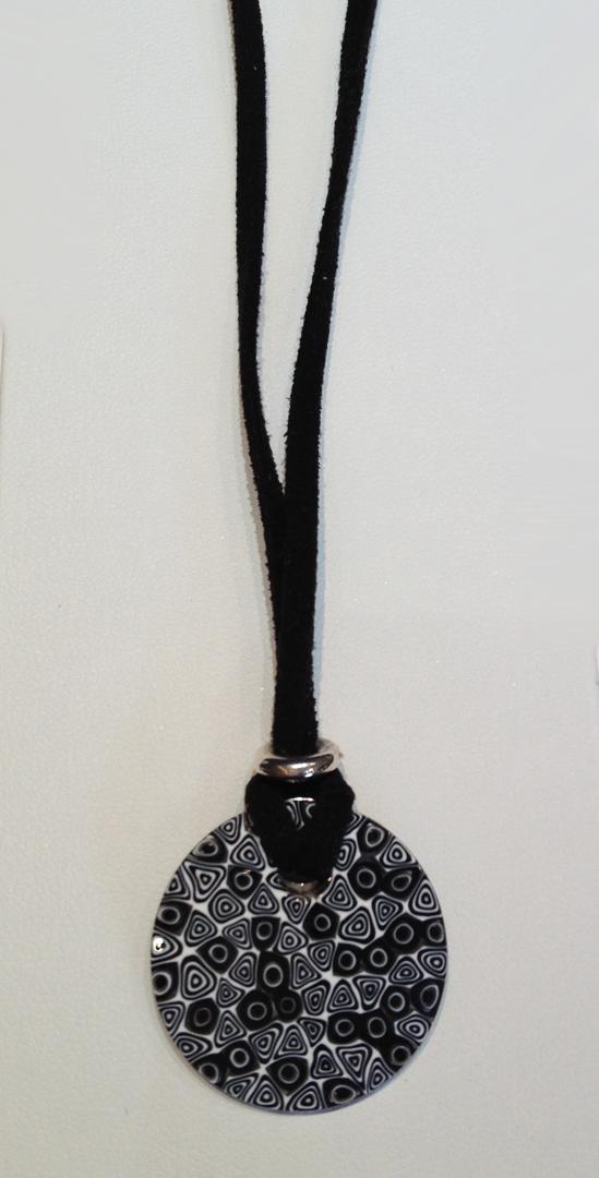 Murrano Milli Fiori glass pendant on leather cord.