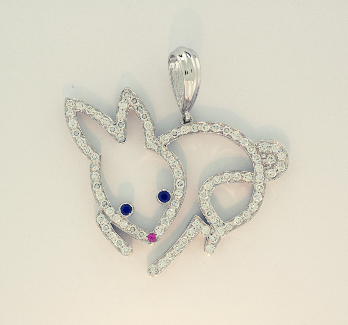 Diamond pavé bunny pendant with sapphire accents in  14KT white gold