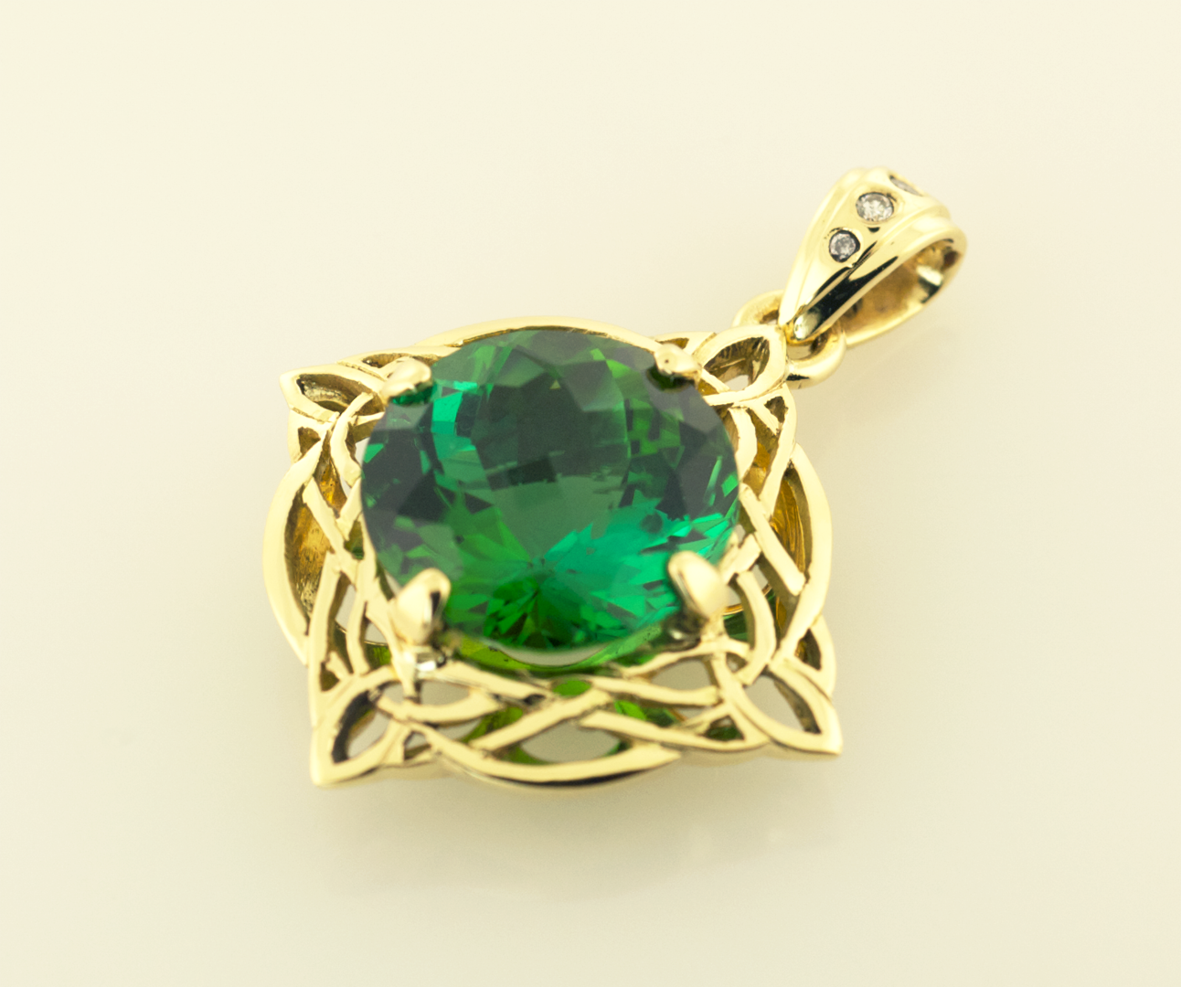 Green Tourmaline, 5.82cts. set in 18KT yellow Gold Celtic Motif Pendant