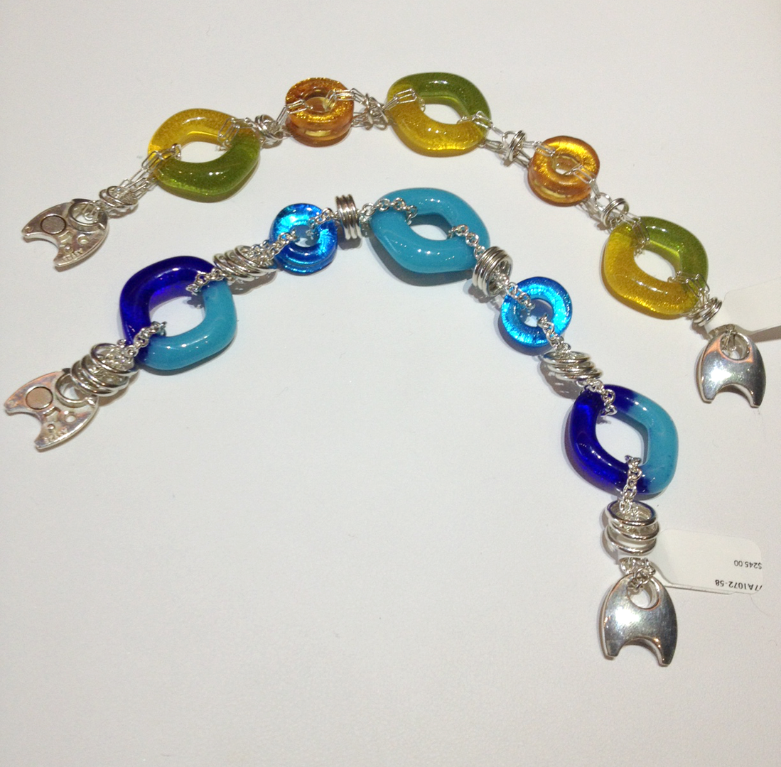 Glass and sterling bracelets, by Nora