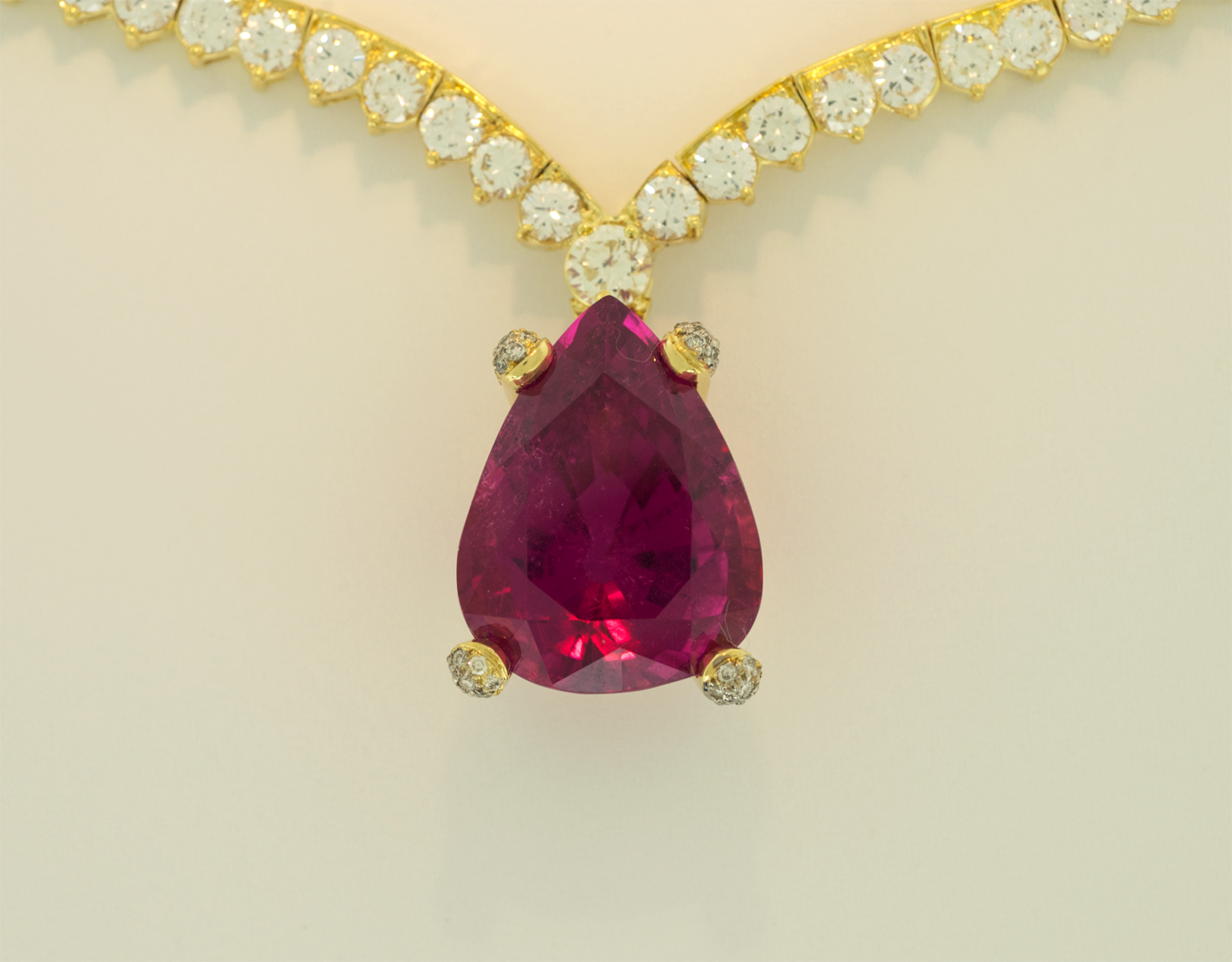 Hot Pink Tourmaline set in 18KT gold on diamond Riviera  necklace