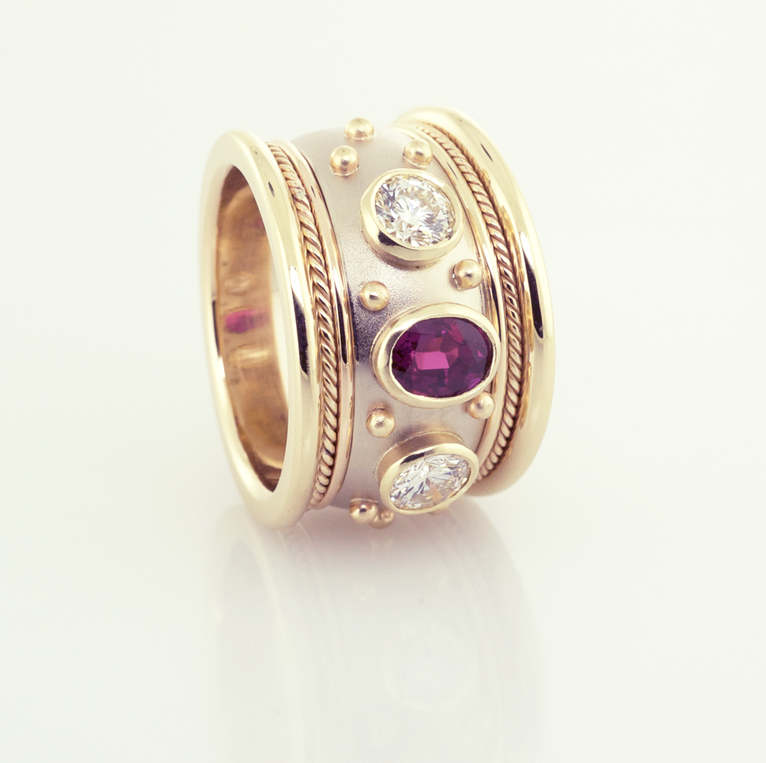 Ruby and diamond cigar ring in 14KT white and yellow gold, front view