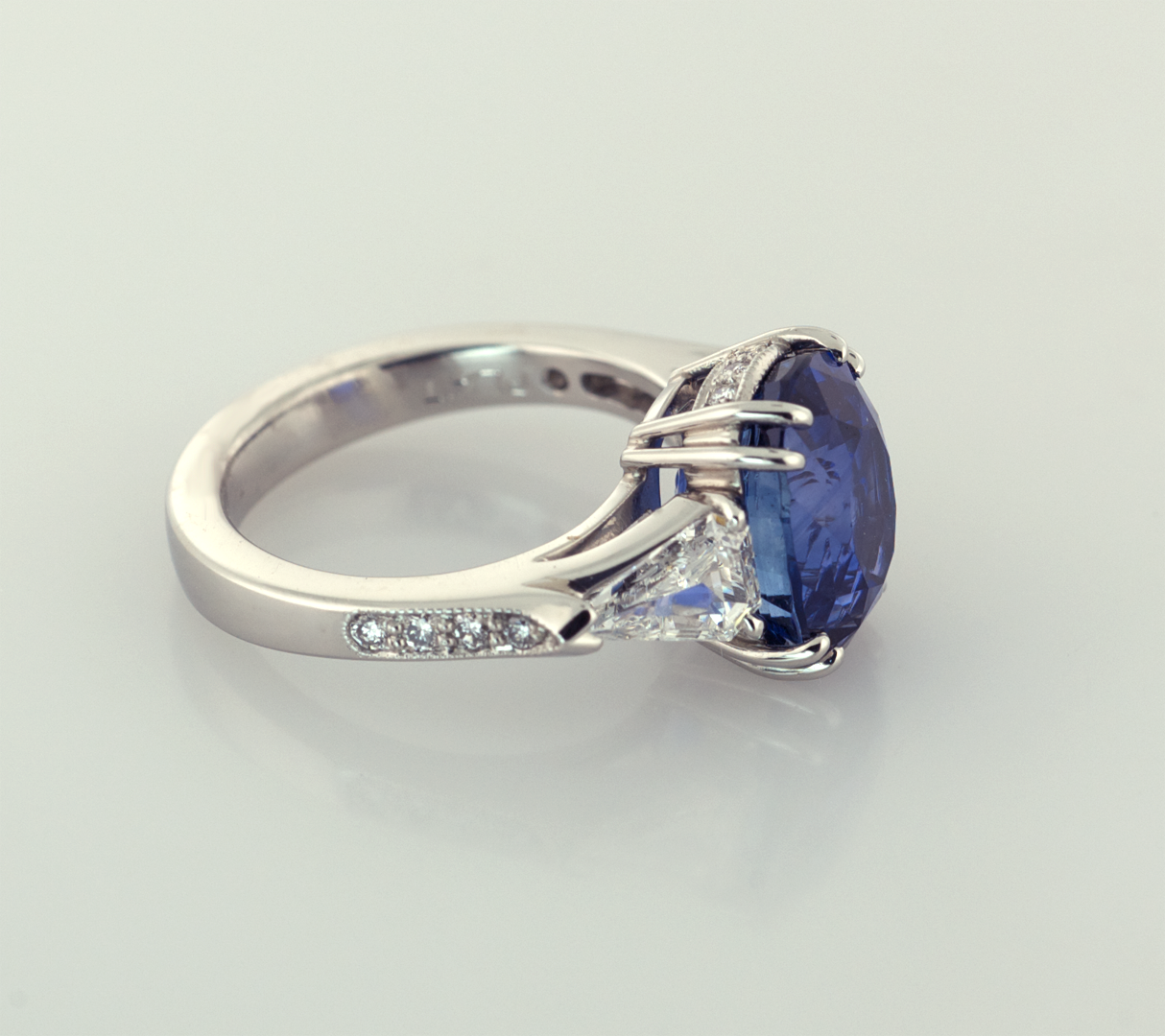 Oval Sapphire 3.50ct. and Trilliam Shape Diamonds Platinum Ring, Side View