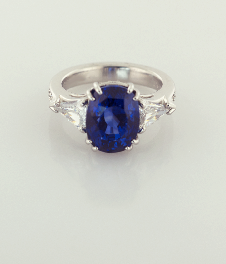 Oval Sapphire 3.50ct. and Trilliam Shape Diamonds Platinum Ring