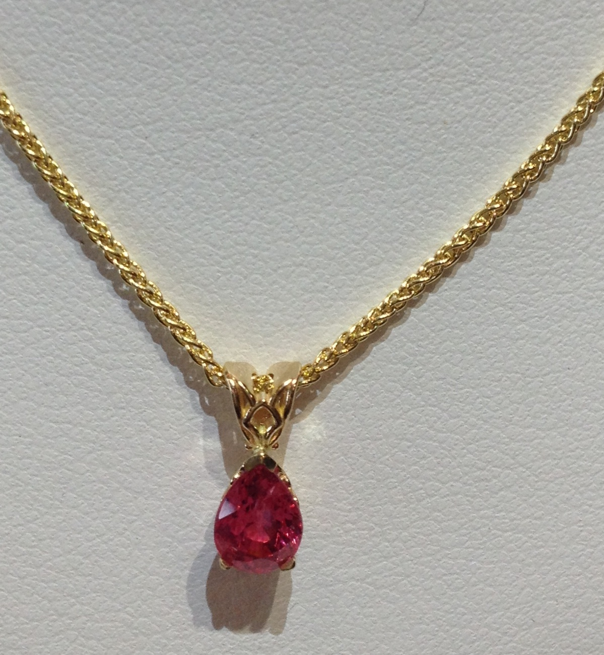 1.09ct. pink Burmese spinel set in 14KT yellow gold on a 14KT yellow gold chain