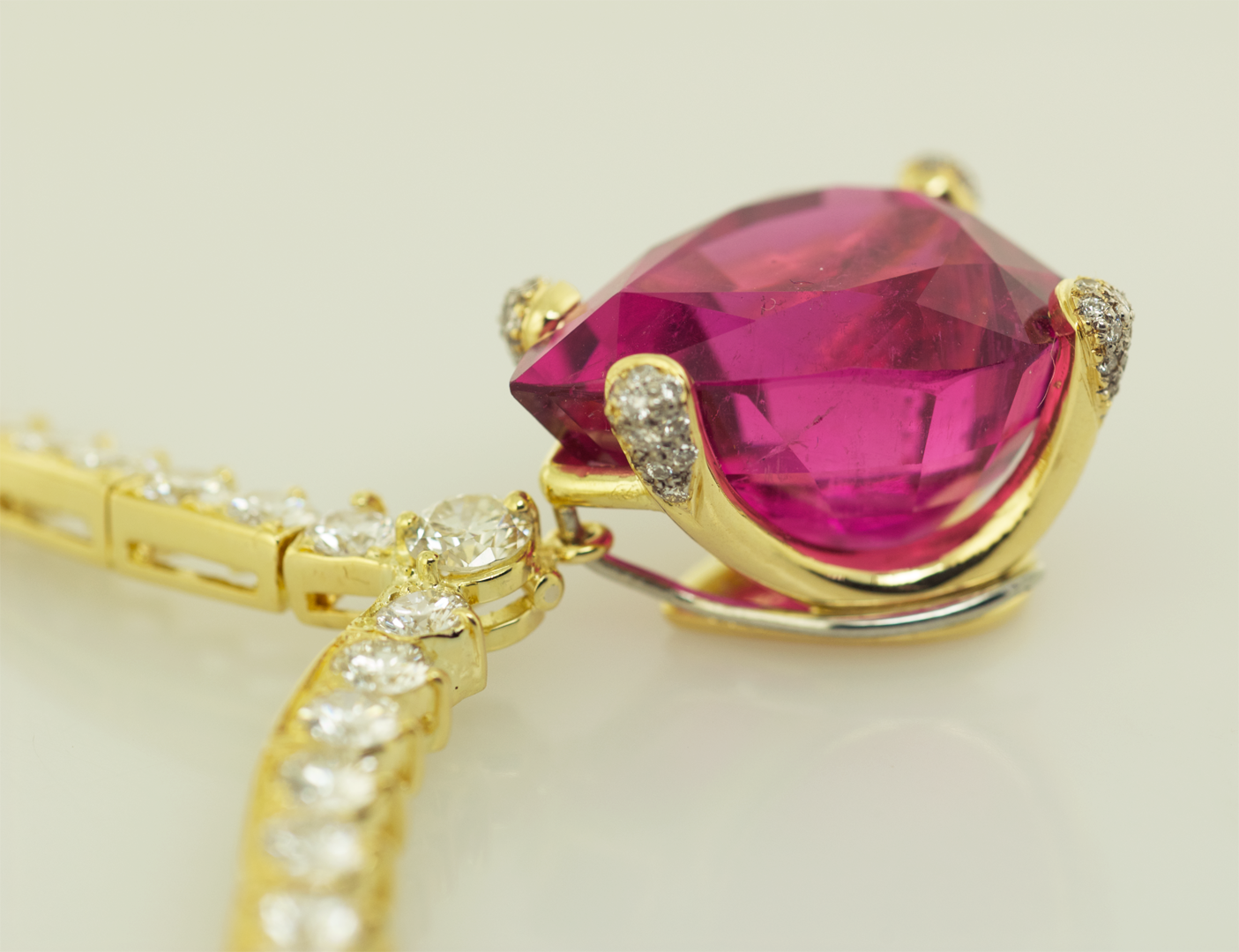 Hot Pink Tourmaline set in 18KT gold on diamond Riviera  necklace, close up