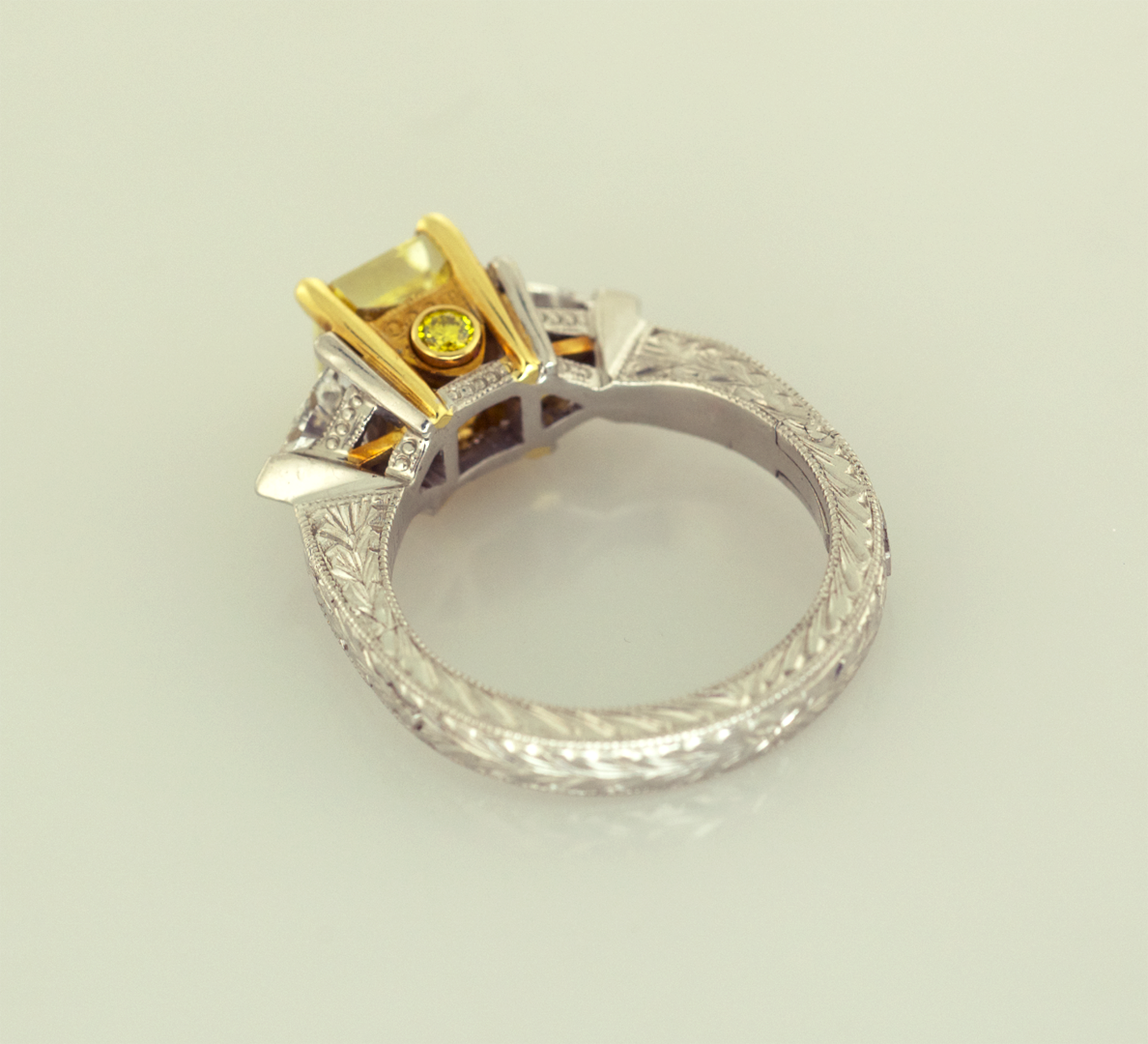 Fancy Intense Yellow Diamond set in Traditional Three ...