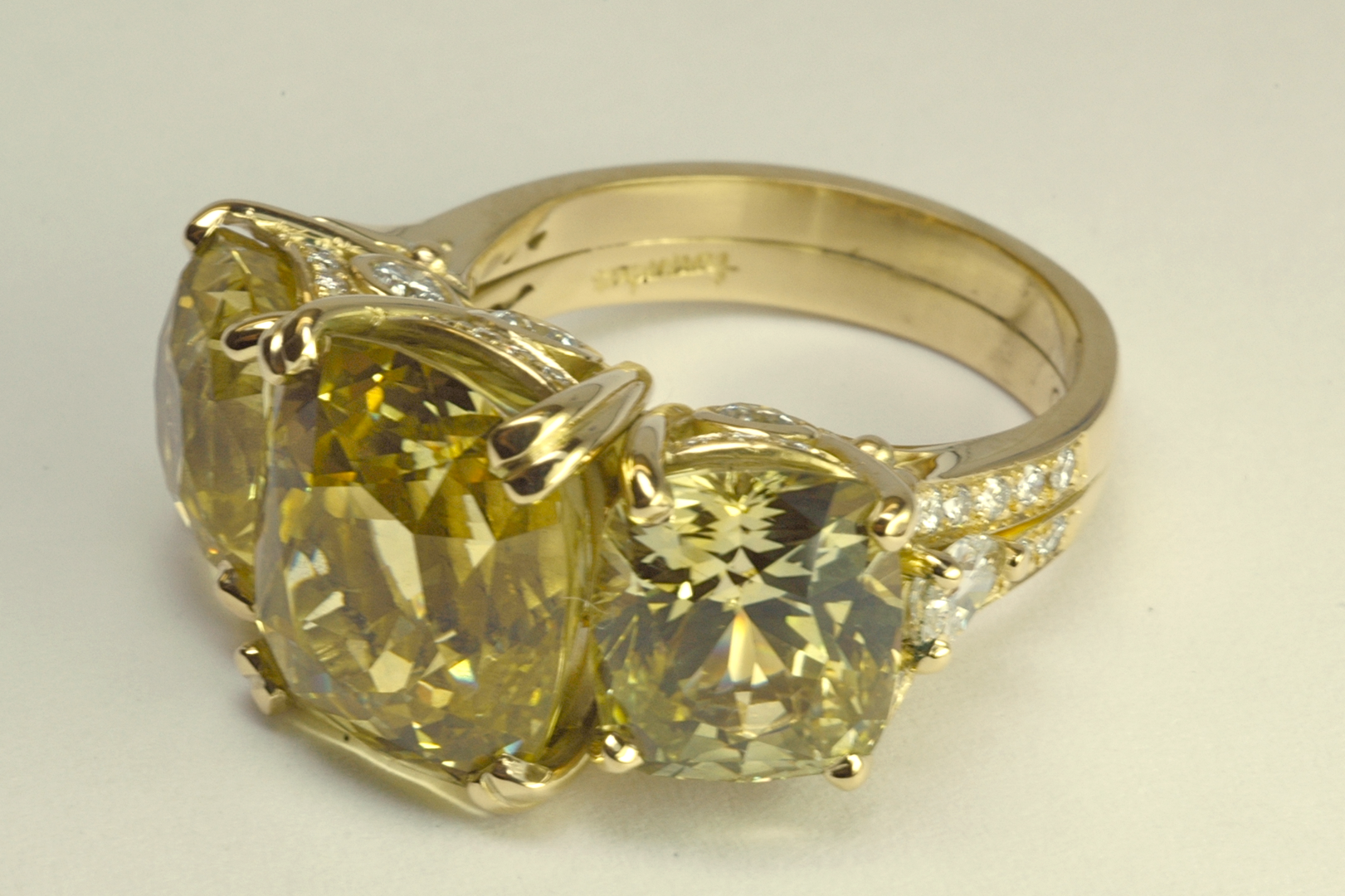 Yellow sapphire suite, three stone ring in 18KT yellow gold with diamond accents