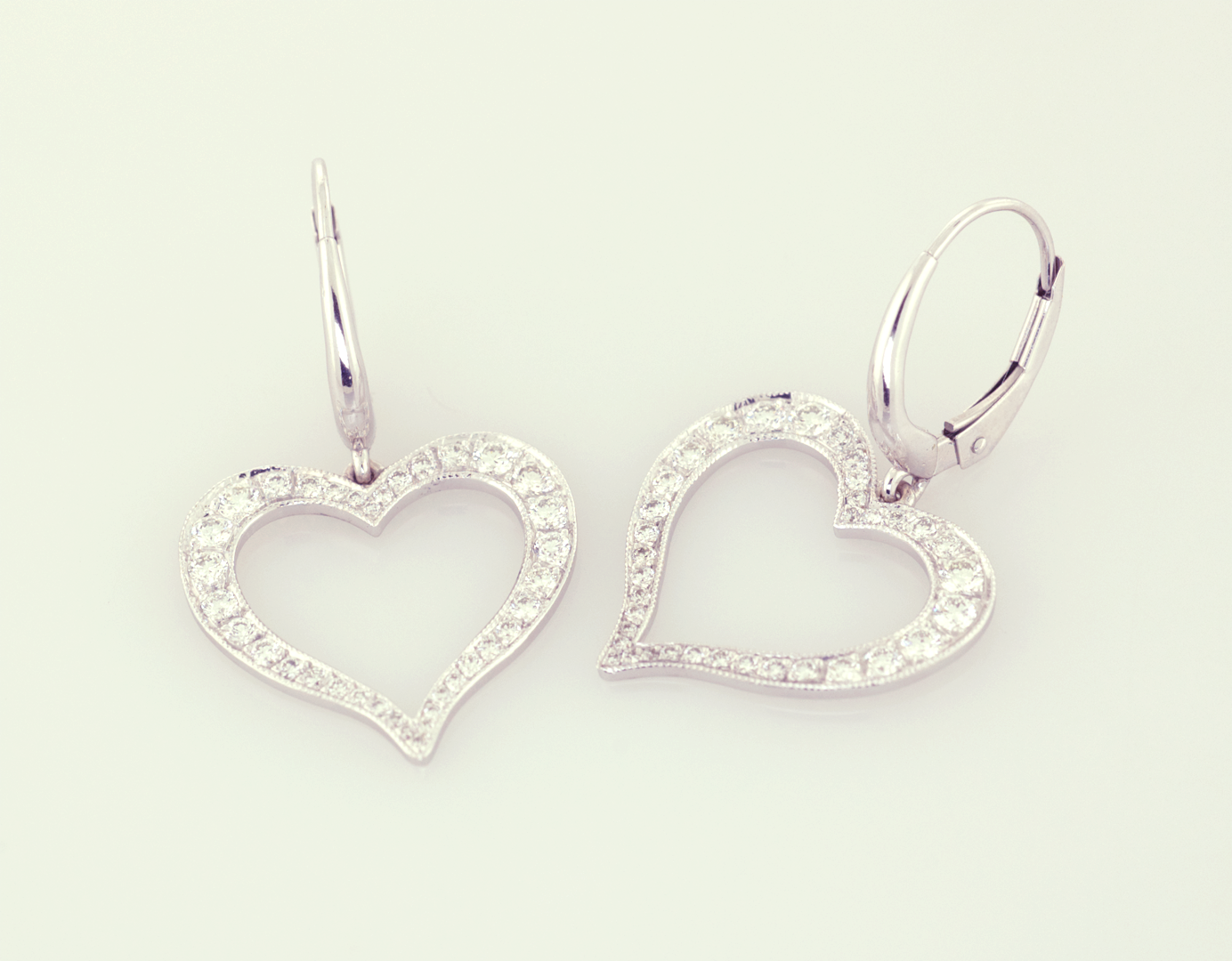 Diamond and 18KT white gold heart earrings