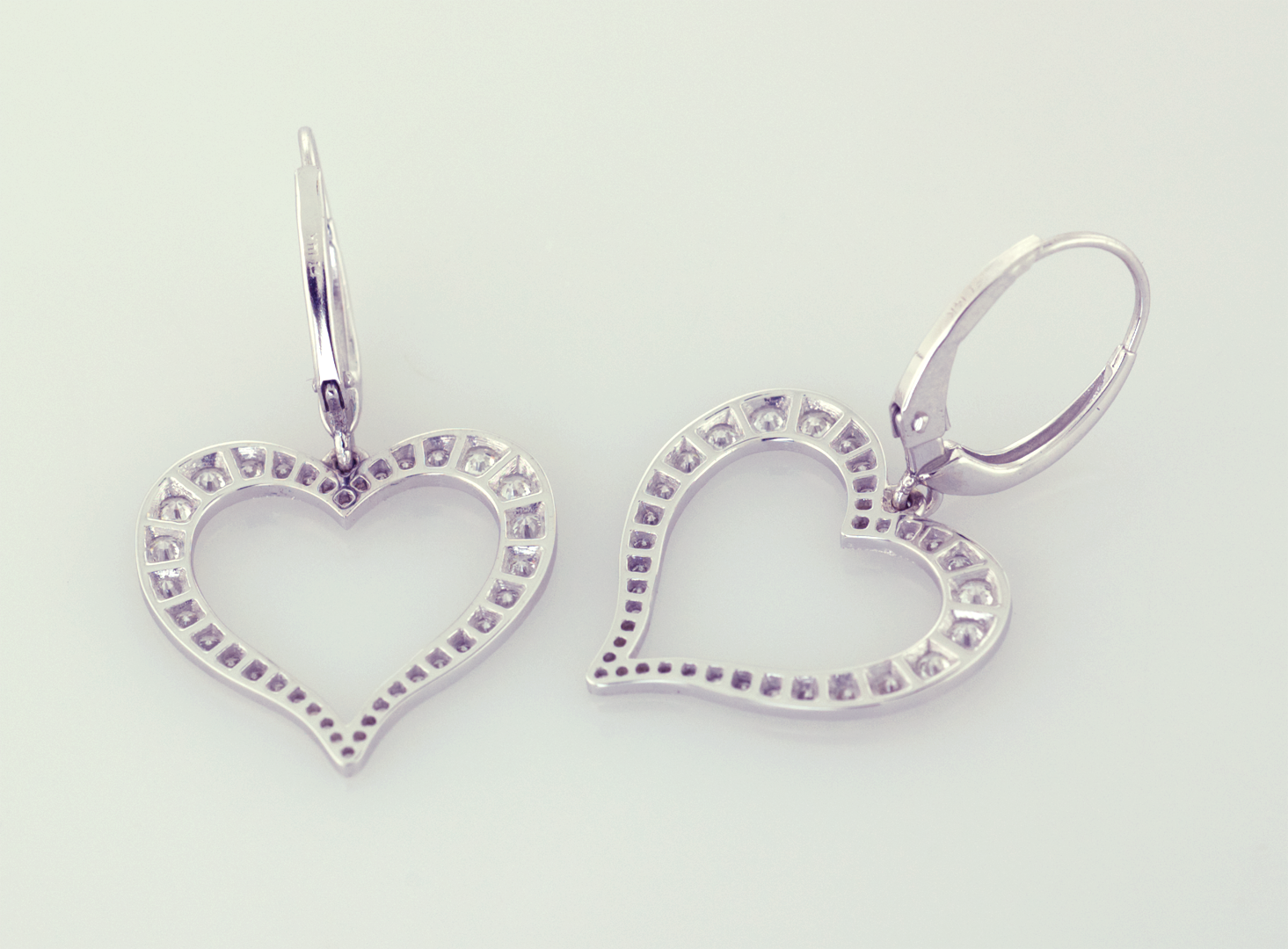 Diamond and 18KT white gold heart earrings, back view