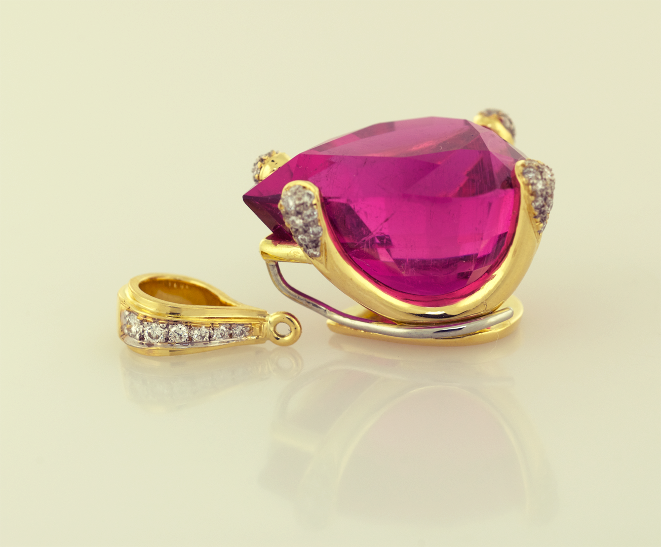 Hot Pink Tourmaline set in 18KT gold and articulating diamond pavé bail & prongs
