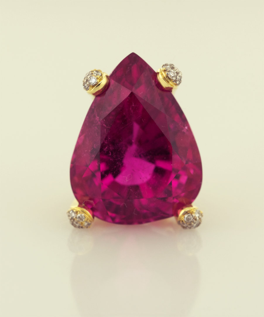 Hot Pink Tourmaline set in 18KT gold and diamond pavé prongs