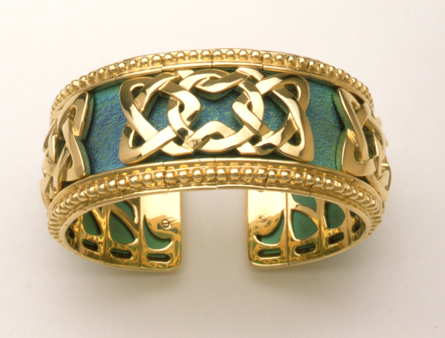 Gold and Titanium Celtic Knot Flexible Cuff Gold and Titanium