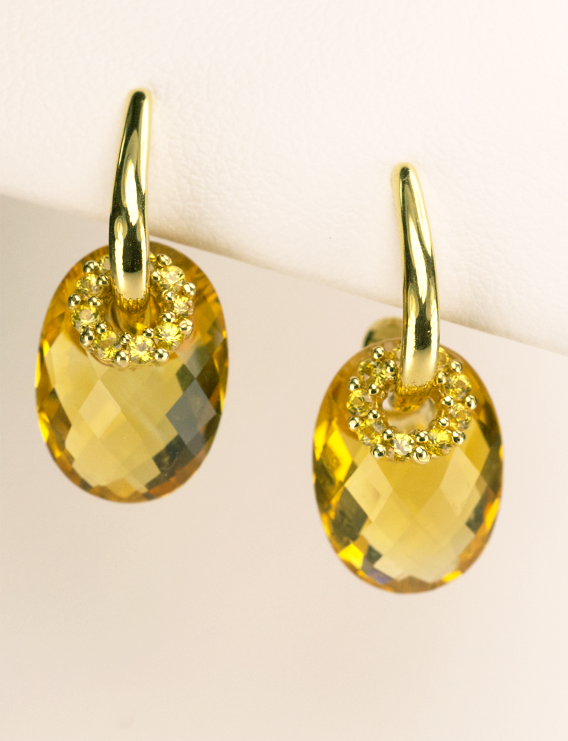 over the le ys on moon hilary products earrings yellow phoenix sapphire seen as duff