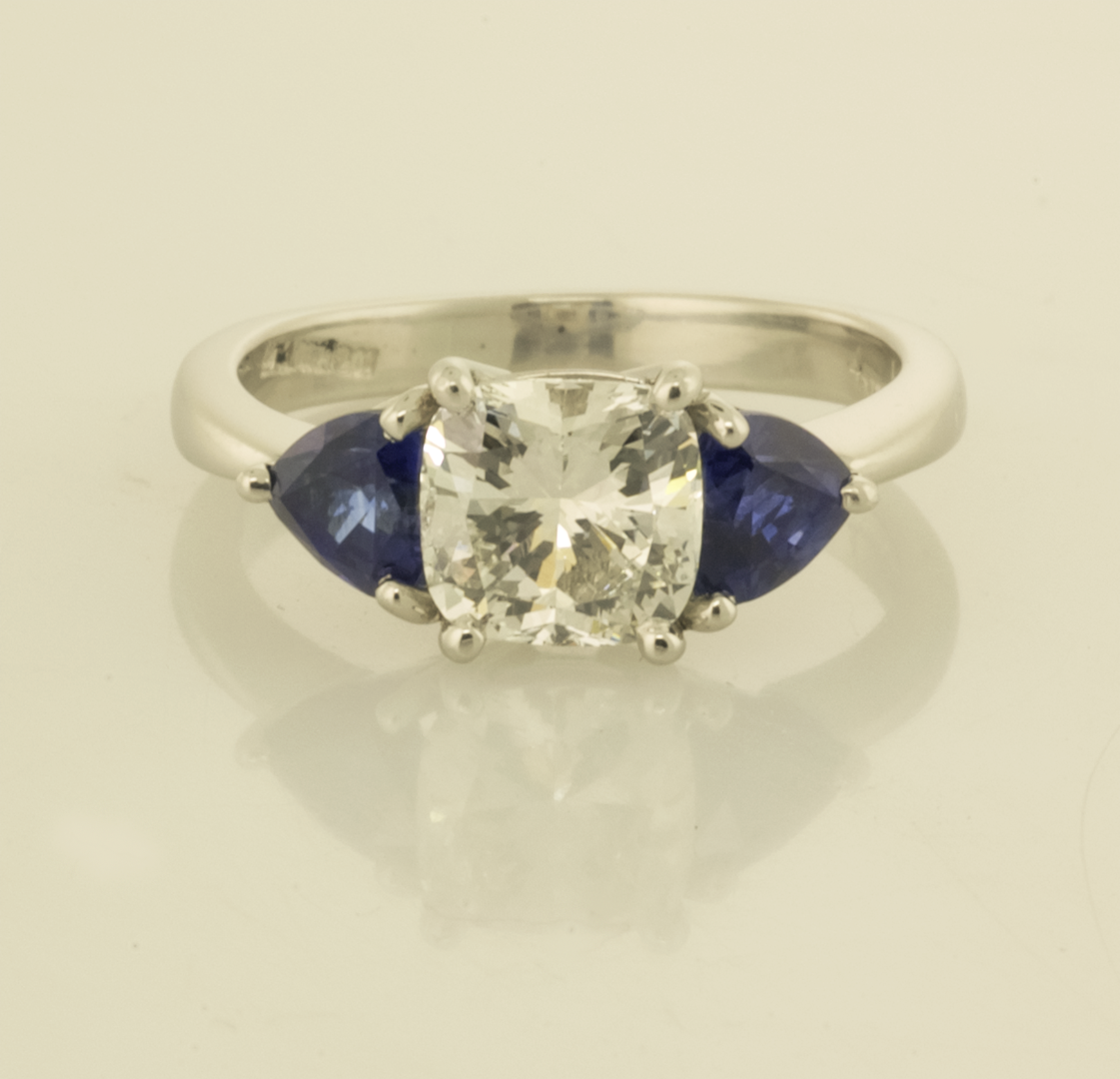 Platinum Three Stone Ring With Cushion Cut With Trillion Shaped