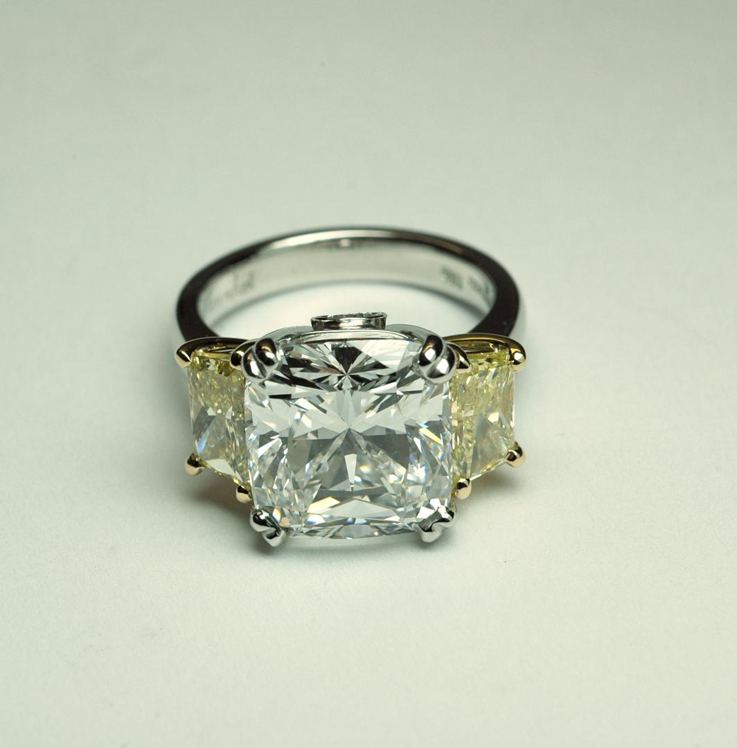 Three stone diamond platinum ring with side yellow diamonds