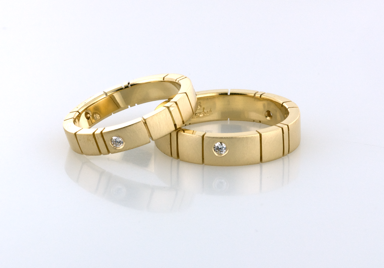 gold wedding bands set with diamonds Copyrighted Original by Thomas Michaels