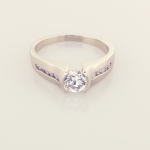 18KT white gold modern solitaire set with 1.00ct. center and .20ct. side diamonds