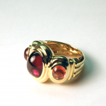 18KT gold and sapphires, cabochon cut, ring.