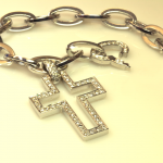 18KT white gold and diamond pavé cross on gold link bracelet