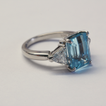 6.50ct. Aquamarine and .60ct. trillion diamond three stone platinum ring