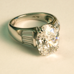 5.00ct. oval diamond and baguette side diamonds set in platinum