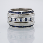 Diamond and Sapphire ring with two textured 18KT white gold bands and two sapphire beveled eternity bands