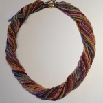 Multi color multi strand glass bead necklace