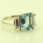 3.78ct.natural emerald cut aquamarine and diamond baguettes (1.15ct.) platinum three stone ring