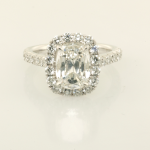 Cushion cut center diamond with diamond surround solitaire