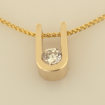 14KT Gold and Diamond Pendant on 14KT wheat chain.