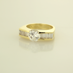 Diamond and 18KT yellow gold ring set with 2.00ct center and 1.20ct. side baguettes