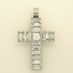 Platinum cross  set with round brilliant shape diamond and baguette diamonds