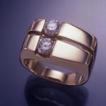 14KT yellow gold set with 2 - .85ct. round brilliant shape diamonds