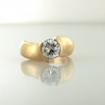 18KT yellow gold and diamond (1.00ct.) solitaire modern ring
