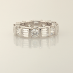 Diamond and platinum eternity band set with round (1.40ct.) and baguette(2.10ct.) diamonds