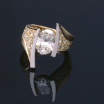 Oval diamond (2.50ct.) and gold modern 18KT ring with platinum and diamond pavé accents