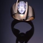 Gold and pear shape (2.00ct.) diamond modern solitaire ring.