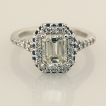 Emerald Cut Diamond Solitaire with Halo of diamonds and sapphires