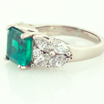 Emerald and diamond ring set in platinum and 18KT yellow gold.