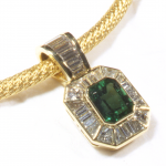 Emerald (4.00ct.) and diamond (4.25ct.) pendant in 18KT yellow gold