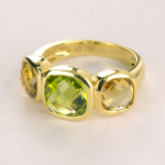 Citrine bezel set three stone ring in 18KT yellow gold