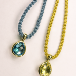 18KT yellow gold pear shape  pendants, one with blue topaz, one with citrine
