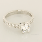 Platinum and Diamond Solitaire with Accent Diamond Pavé