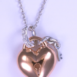 Rose gold plated sterling silver heart wet with .05ct. diamonds
