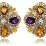 Pear Shape Amethyst and citrine, surrounded by diamonds set in 18KT yellow gold