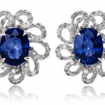 Blue Sapphire and diamond earrings set in a floral motif